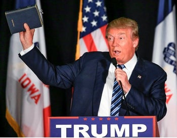 Republican presidential candidate Donald Trump holds up his Bible during a campaign stop in Council Bluffs, Iowa, Tuesday, Dec. 29, 2015.