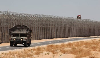 An Israeli military vehicle drives along the Egyptian border in 2013.