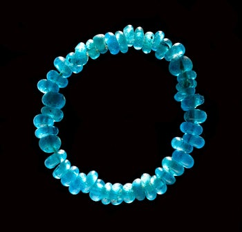 The women buried in ancient Denmark were interred with jewelry, such as this blue glass necklace.