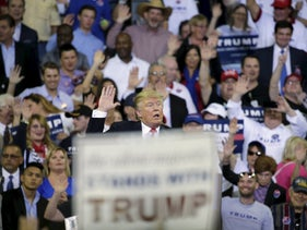 Presidential candidate Donald Trump asks his supporters to raise their hands and promise to vote for him at a rally in Orlando, March 5, 2016.