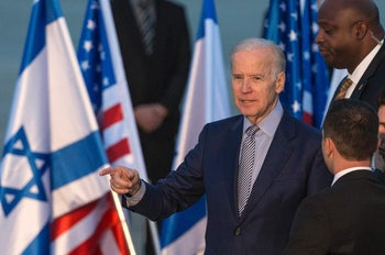 US Vice President Joe Biden gestures upon his arrival at Israel's Ben Gurion International airport on March 8, 2016.