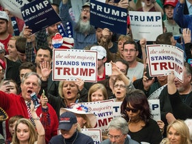 Donald Trump supporters cheer on the Republican presidential candidate before a campaign rally March 7, 2016 in Concord, North Carolina.