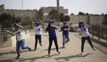 Filipino tourists dance near Jaffa gate at Jerusalem's Old City, January 9, 2016.