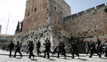 Israeli police forces walk by Jaffa Gate in Jerusalem's Old City as they patrol the area, on March 9, 2016.