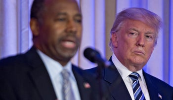 Donald Trump, right, looks on as Ben Carson speaks during a news conference in Palm Beach, Florida, on Friday, March 11, 2016.