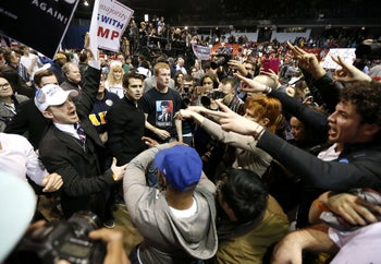 Supporters of Donald Trump, left, face off with protesters after a rally at University of Illinois-Chicago was cancelled due to security concerns, March 11, 2016.