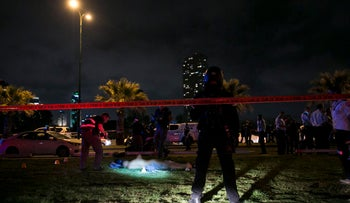 Lifeless body of Palestinian assailant behind stabbing rampage that left one dead in Jaffa after he was shot by a police volunteer near Tel Aviv.