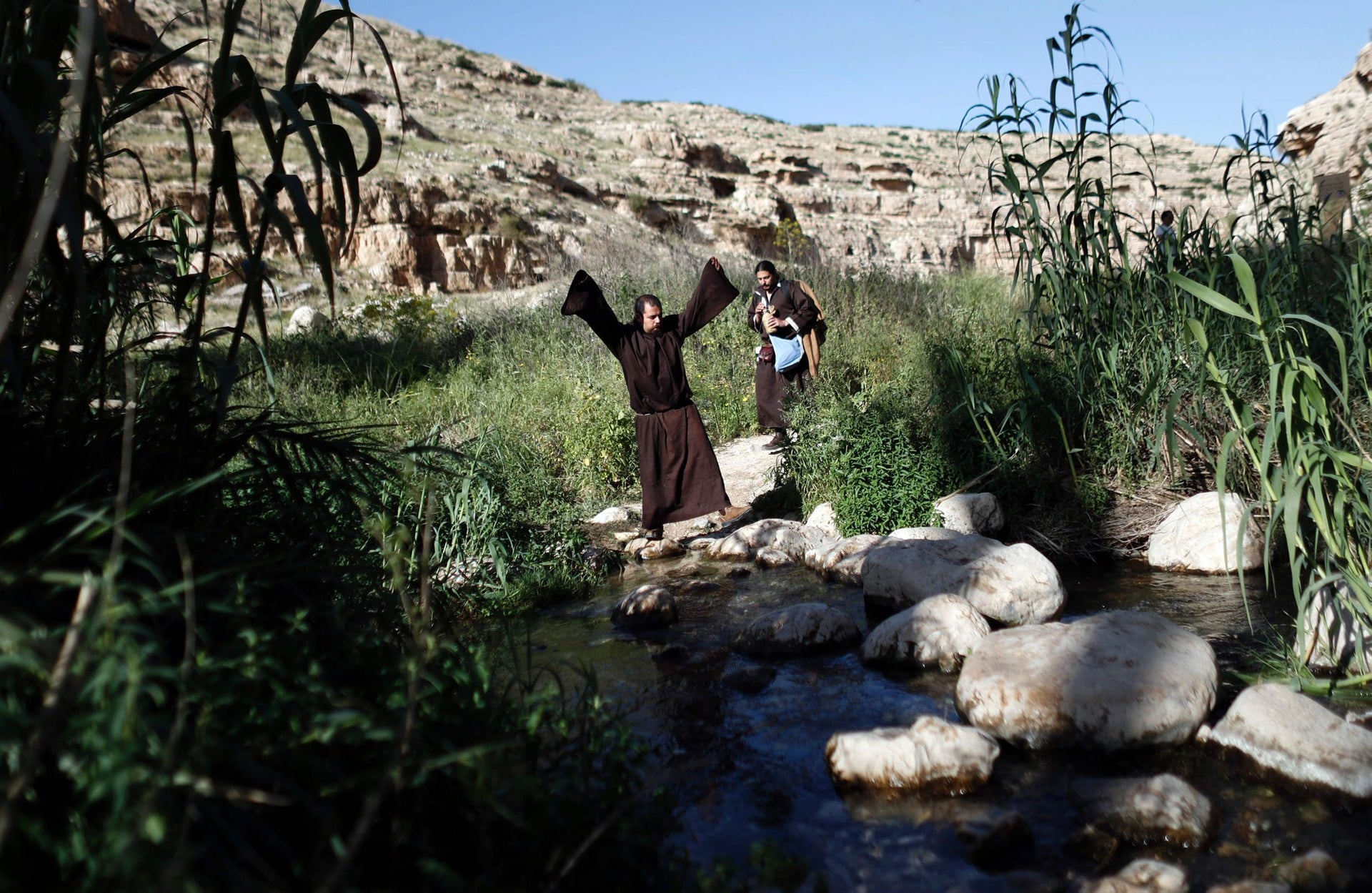 Israeli enthusiasts walk in the Jordan valley near Jericho as they take part in a three day walk on March 11, 2016 between the West Bank city of Jericho and Jerusalem, as part of an event to re-enact the Curaders' journey.