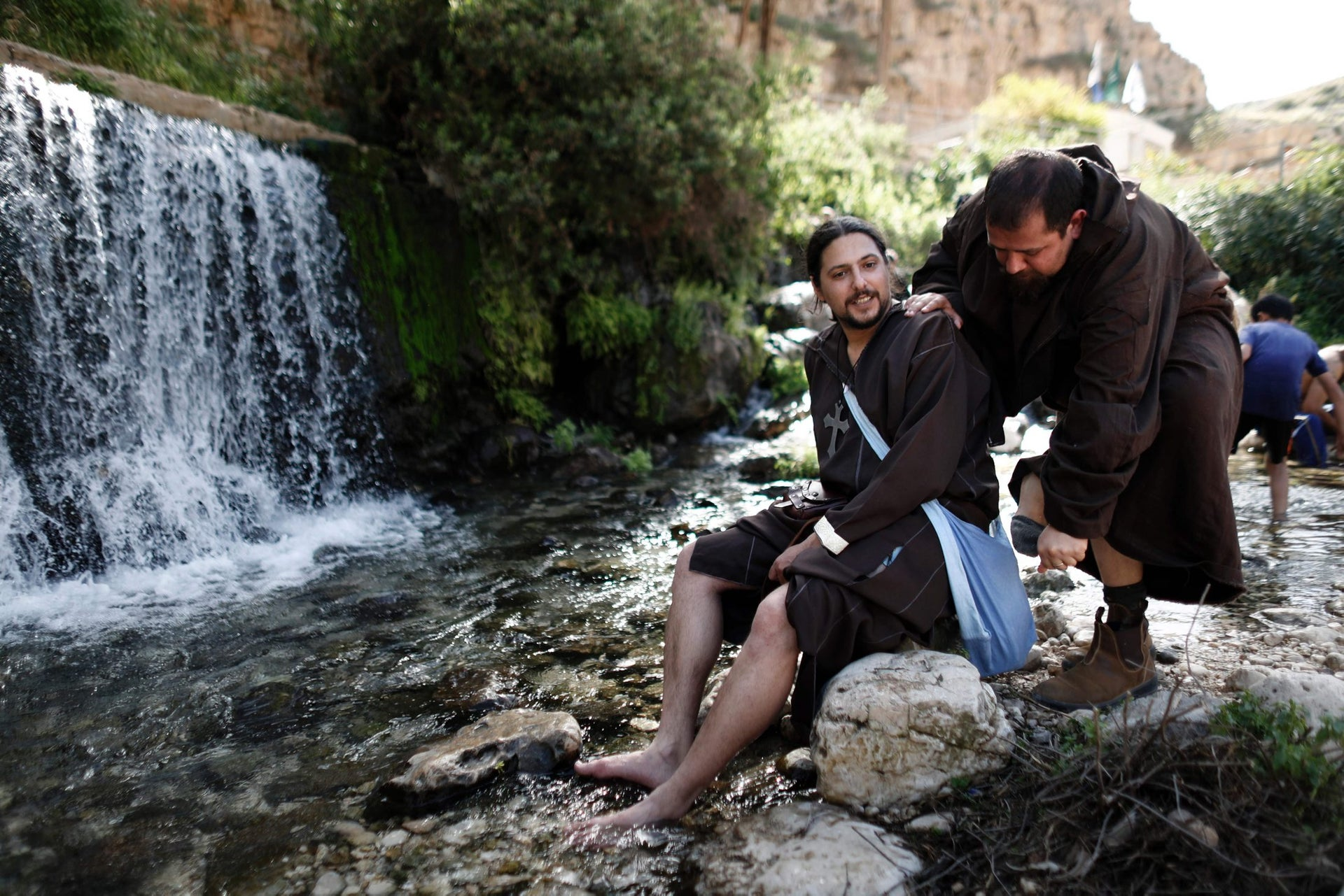 Israeli enthusiasts walk in the natural spring in Ein Fawwar, near the West Bank city of Jericho, as they take part in a three day walk on March 11, 2016 between the West Bank city of Jericho and Jerusalem, as part of an event to re-enact the Curaders' journey.