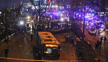 Members of emergency services work at the scene of an explosion in Ankara, Turkey, on Sunday, March 13, 2016.