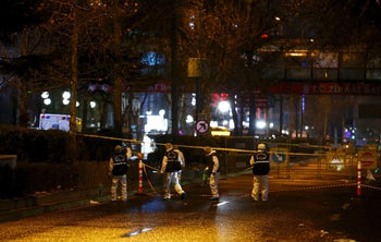 Forensic officers work on the site of a suicide bomb attack in Ankara, Turkey, early March 14, 2016.