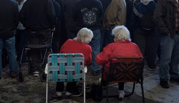 Two elderly women wait for a rally with U.S. Republican presidential hopeful Donald Trump on March 14, 2016 in Vienna Center, Ohio.