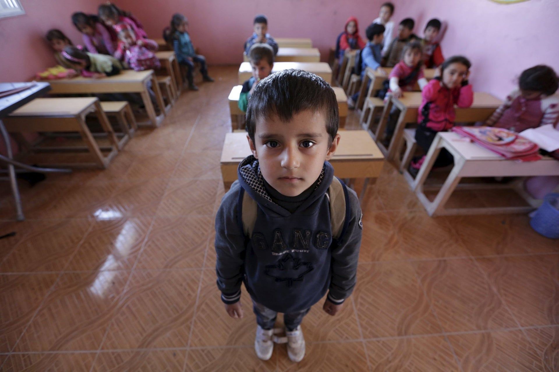 Five-year-old Wael al-Tawil poses inside a classroom in the rebel-controlled area of Maarshureen village in Idlib province, Syria  March 12, 2016.