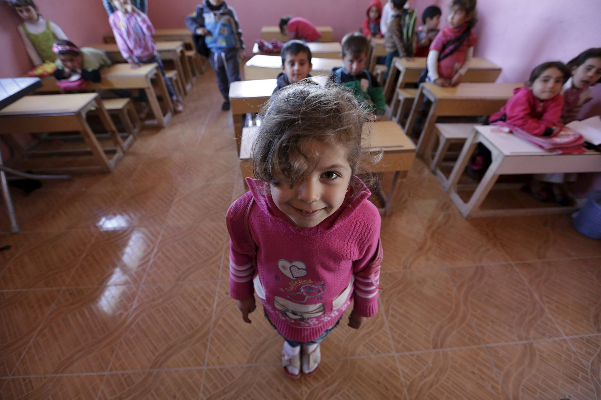 Five-year-old Jana Mahmoud poses inside a classroom in the rebel-controlled area of Maarshureen village in Idlib province, Syria, March 12, 2016.