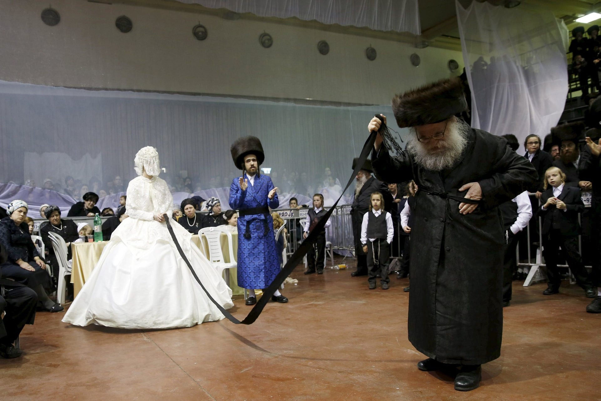 An ultra-Orthodox Jewish bride takes part in the 'mitzva tantz', the custom in which relatives dance in front of the bride after her wedding ceremony, in Netanya, Israel, early March 16, 2016. Thousands took part in the wedding of the grandson of Rabbi Yosef Dov Moshe Halberstam, religious leader of the Sanz Hasidic dynasty and the granddaughter of the religious leader of Toldos Avraham Yitzchak Hasidic dynasty, in Netanya on Tuesday night.