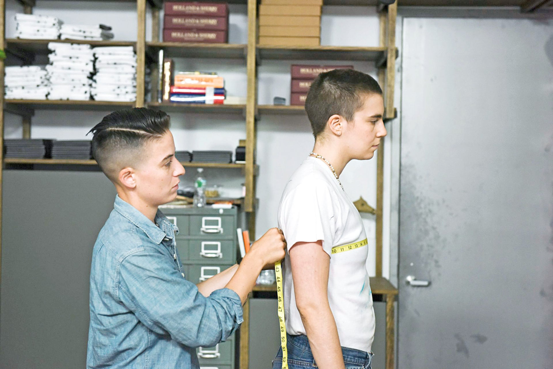 Rae Tutera measures Grace Dunham in a scene from 'Suited.'