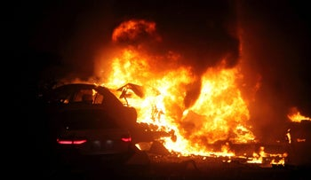A burning car after a blast in the Turkish capital, Ankara ripped through a busy square killing 27 people and wounding 75 more, March 13, 2016.