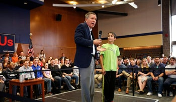 Ohio Governor and Republican presidential candidate John Kasich reacts to a young attendee's question during a town hall event near Philadelphia, Pennsylvania, March 16, 2016.