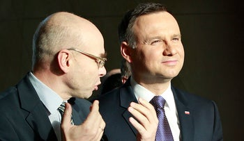 Polish President Andrzej Duda, right, and Dariusz Stola, the director of the Museum of the History of Polish Jews, visit the museum in Warsaw, Poland, March 3, 2016.