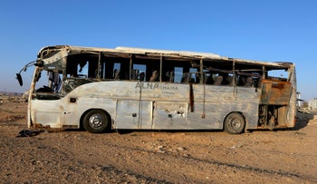 A bus damaged after a crash carrying Palestinian pilgrims en route to Saudi Arabia, on the outskirts of Maan, Jordan, March 17, 2016.