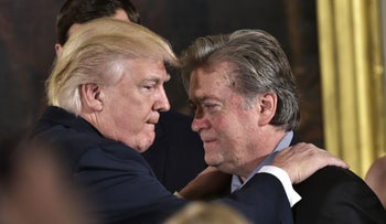 U.S. President Donald Trump congratulates Steve Bannon during the swearing-in of senior staff in the White House, January 22, 2017.