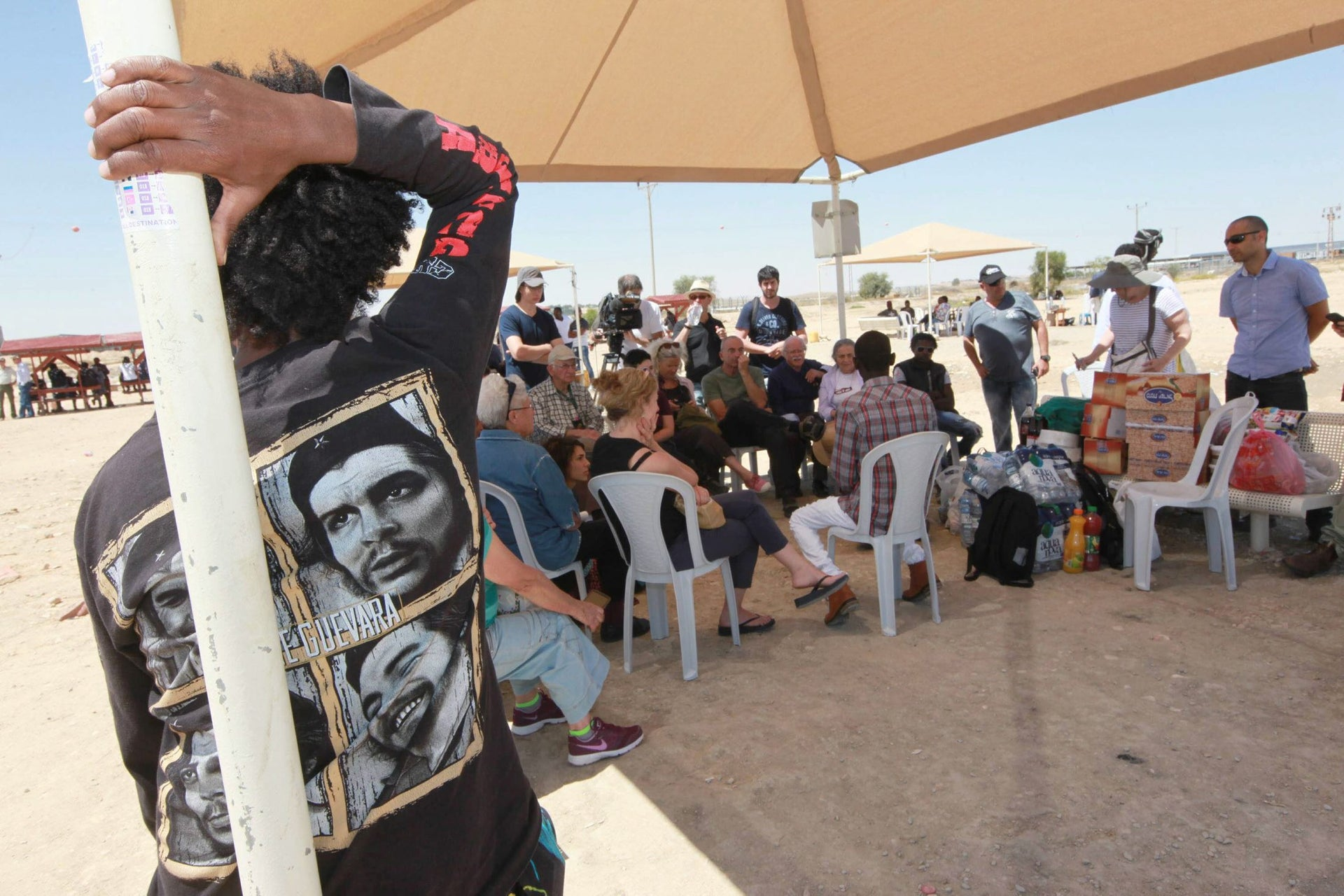 One of the potluck meetings held before the Passover seder at Holot, where asylum seekers were encouraged to share their personal stories, on April 15, 2016.