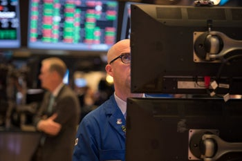 A trader working on the floor at the closing bell of the Dow Jones at the New York Stock Exchange, April 6, 2017.