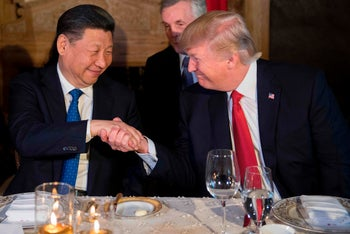 US President Donald Trump (R) and Chinese President Xi Jinping (L) shake hands during dinner at the Mar-a-Lago estate in West Palm Beach, Florida, on April 6, 2017.