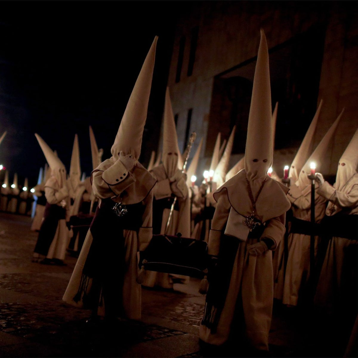 Hooded penitents from the Brotherhood of Jesus in a procession during Holy Week celebrations, Zamora, Spain, Thursday, March 24, 2016. Holy processions take place across Spain as Christians gather to celebrate the week leading up to Easter and the death and resurrection of Jesus Christ.