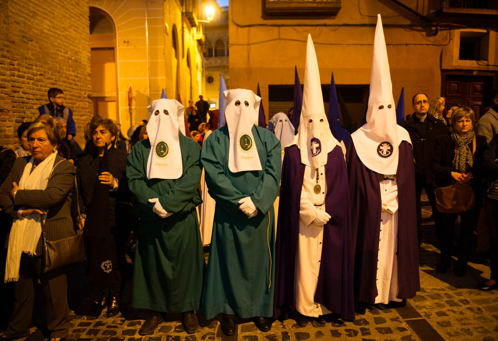 Penitents of the 'Silencio del Santisimo Cristo del Rebate' brotherhood take part during a Holy Week procession in the Spanish village of Tarazona on April 11, 2017.