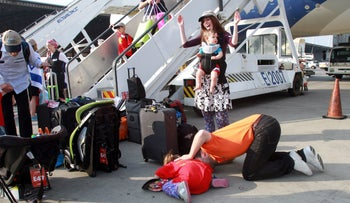 Immigrants from North America kiss the tarmac upon arrival to Ben Gurion Airport.