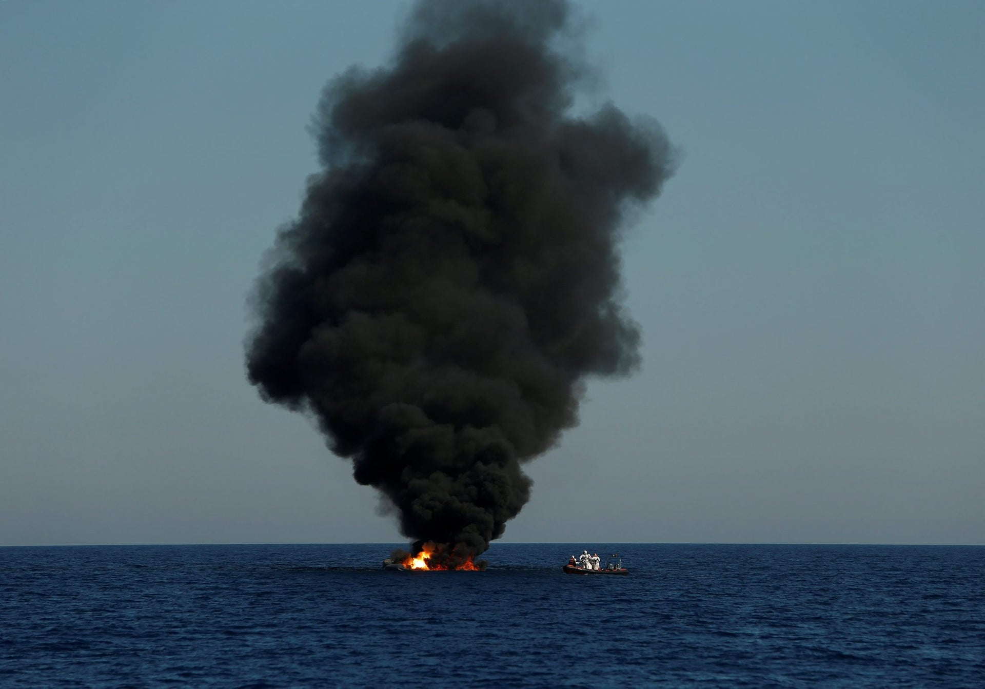 A rubber dinghy is burnt and sunk after the migrants on board were rescued by the Malta-based NGO Migrant Offshore Aid Station (MOAS) in the central Mediterranean in international waters some 15 nautical miles off the coast of Zawiya in Libya, April 14, 2017.