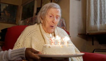 In this Tuesday, Nov. 29, 2016 file photo, Emma Morano, 117 years old, blows candles on the day of her birthday in Verbania, Italy.