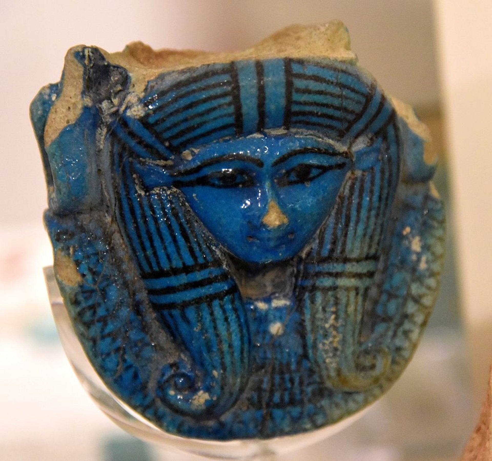 Hathor's head. Faience, from a sistrum's handle. 8th Dynasty. From Thebes, Egypt. T