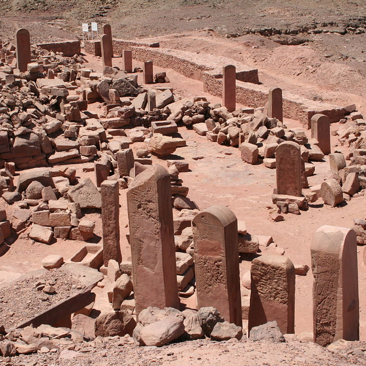 The remains of the giant temple to Hathor built at Serabit el-Khadem, in the Sinai. The picture shows rubble and standing stelae.