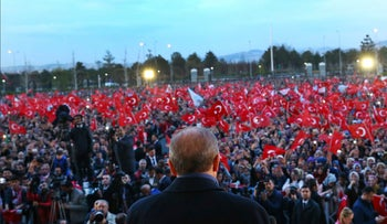 Erdogan delivers a speech during a rally a day after the referendum, outside the Presidential Palace, in Ankara, Turkey, Monday, April 17, 2017.
