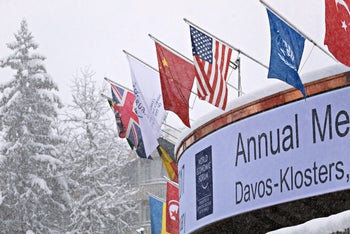 National flags of China, United States, United Kingdom and Turkey hang above the front of the Congress Center, for the World Economic Forum, in Davos, Switzerland, Saturday, Jan. 14. 2017: Turkey's economin status is likely to suffer following the referendum.