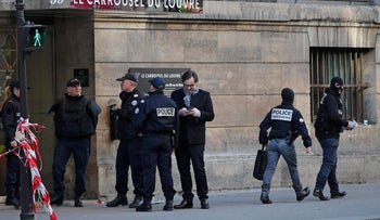French police officers cordon off the area outside the Louvre museum as a soldier opened fire after he was attacked in Paris, February , 2017.