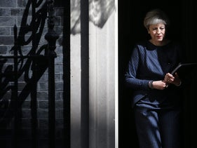 British Prime Minister Theresa May walks out of 10 Downing Street to speak to media in central London on April 18, 2017.