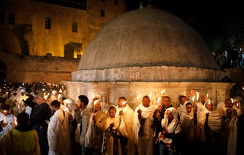 Ethiopian Orthodox worshipers hold candles during the Holy Fire ceremony at the Church of the Holy Sepulchre in Jerusalem's Old City April 15, 2017.