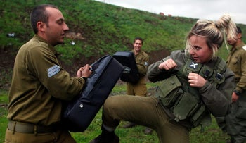 A female Israeli soldier takes part in a Krav Maga training at a military base in the Golan Heights, March, 2017.