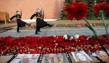 Members of the honor guard march by the Kremlin during a memorial commemorating the victims of the St. Petersburg metro blast.
