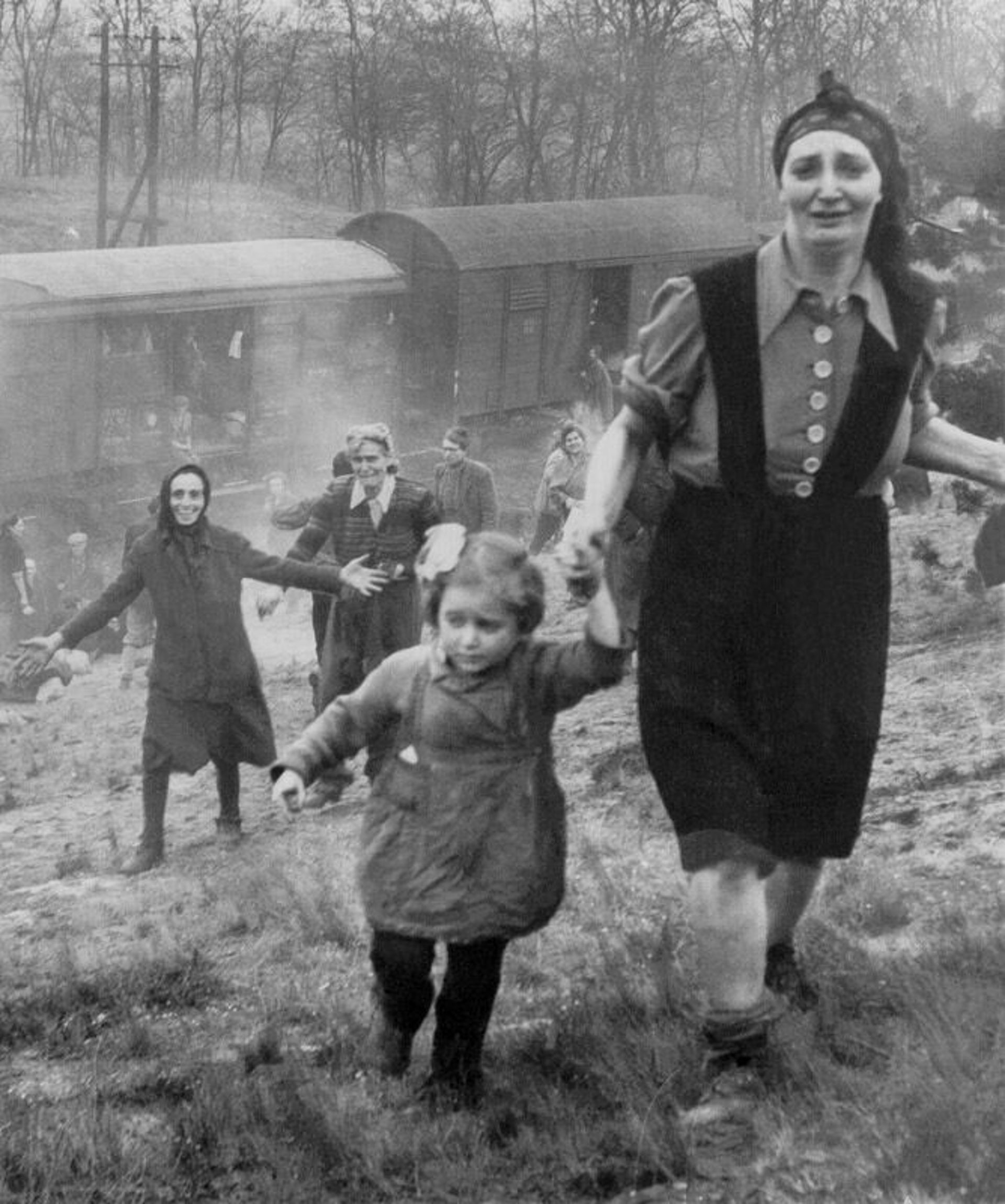 Still-unidentified women, moments after liberation, April 13, 1945.