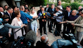 German Foreign Minister Sigmar Gabriel (C) speaks to journalists during a press conference at a hotel in Jerusalem on April 25, 2017.