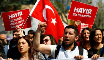 Anti-government demonstrators shout slogans during a protest in Istanbul, Turkey, April 23, 2017.