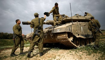 Israeli soldiers with a tank near Israel's border with Gaza, February 28, 2017.