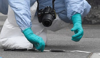 A forensic investigator recovers knives after man was arrested on Whitehall in Westminster, central London, Britain, April 27, 2017.