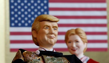 Japanese doll-maker Kyugetsu Inc.'s dolls depicting U.S.President Donald Trump, left, and former Democratic presidential nominee Hillary Clinton, at the company's main shop in Tokyo, January 2017.
