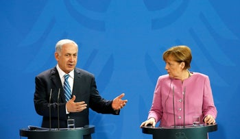Prime Minister Benjamin Netanyahu and German Chancellor Angela Merkel address a news conference at the Chancellery in Berlin, Germany, February 16, 2016.
