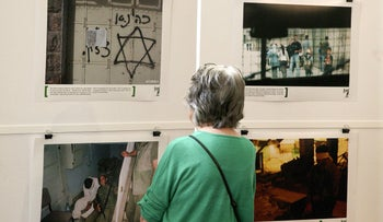 A visitor looks at the exhibition 'Breaking the Silence' at the Kulturhaus Helferei in Zurich, June 8, 2015.